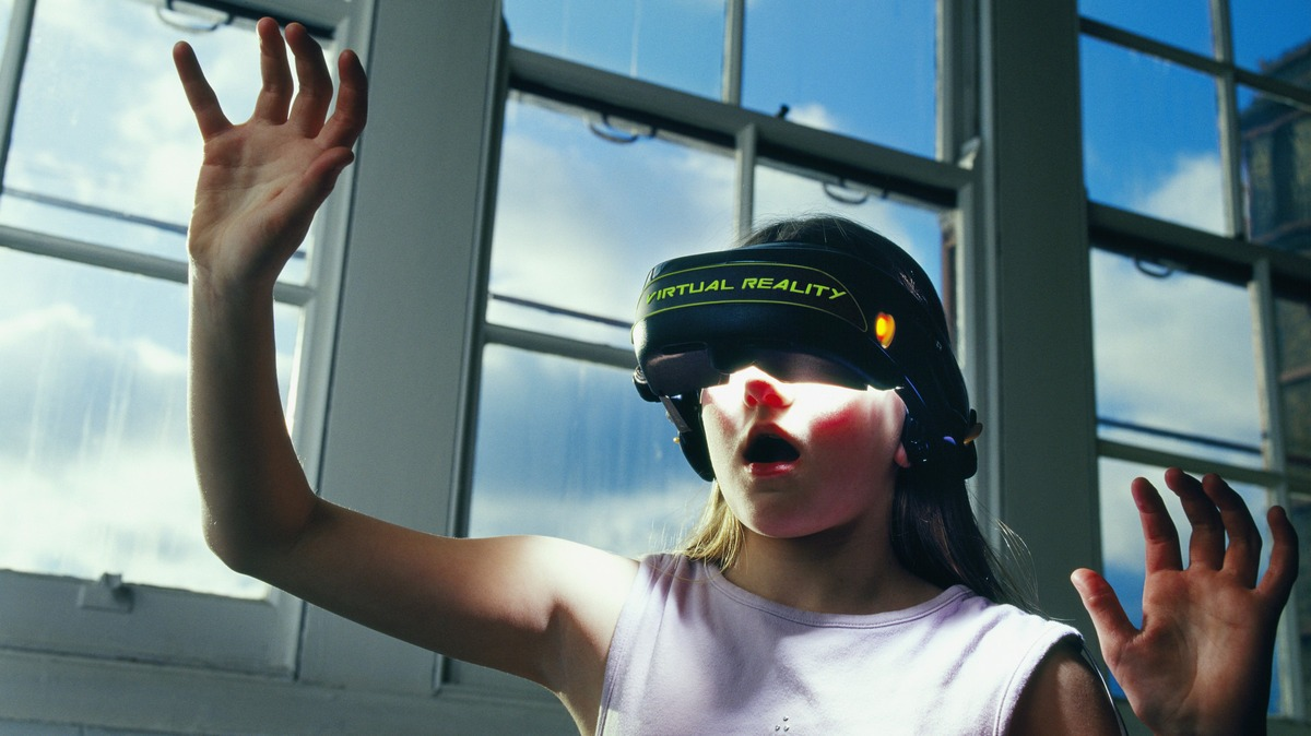 Girl Using Virtual Reality Simulator