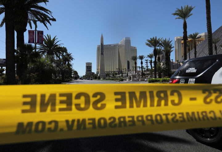 Police crime scene tape marks a perimeter outside the Luxor Las Vegas hotel and the Mandalay Bay Resort and Casino, following a mass shooting at the Route 91 Festival in Las Vegas, Nevada, U.S., October 2, 2017.  REUTERS/Mike Blake